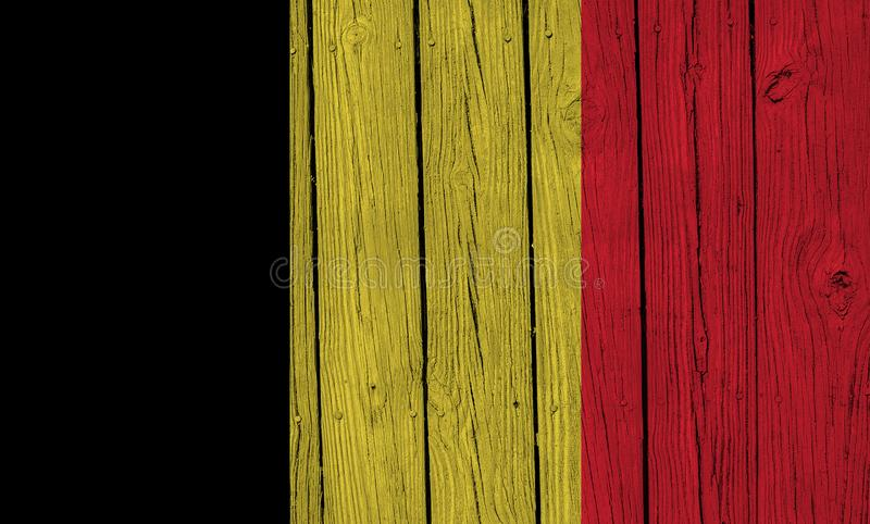 Belgium Flag Over Wood Planks. A grunge Belgium flag over wood planks stock images