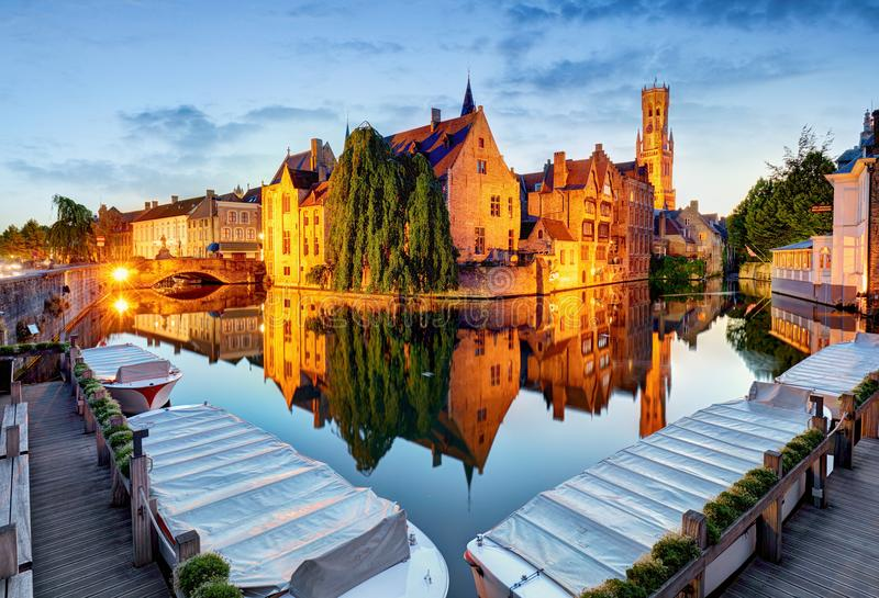 Belgium - Historical centre of Bruges river view. Old Brugge bu. Ildings reflecting in water canal stock photos