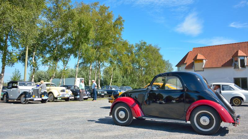 Beatiful black and red old timer at a car show in oudenburg, Belgium. Belgium, Oudenburg, August 2018: beautiful black and red old timer at a car show in stock photography