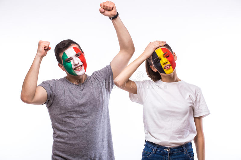 Belgium vs Italy. Football fans of national teams demonstrate emotions: Belgium lose, Italy win. European football fans concept stock images