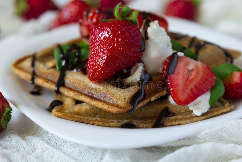 Belgium waffles dessert with strawberries, ricotta cheese and chocolate. Selective focus. Belgium waffles with strawberries, ricotta cheese and chocolate on stock photos