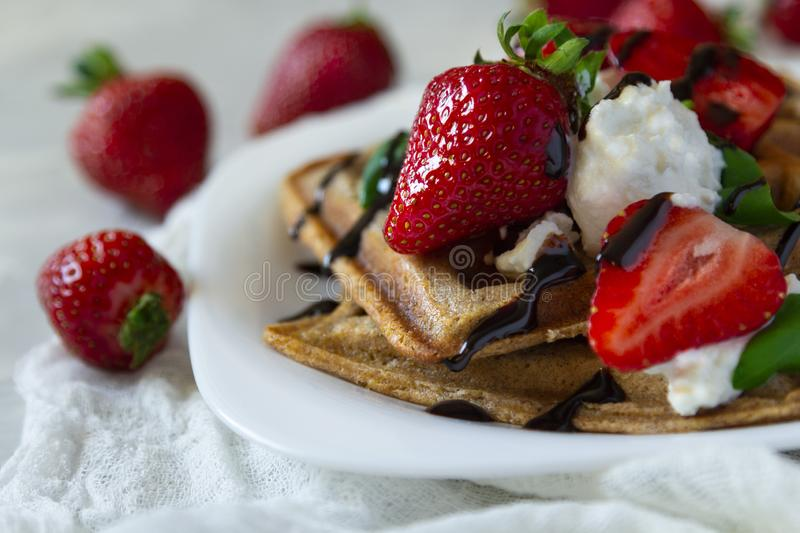 Belgium waffles dessert with strawberries, ricotta cheese and chocolate. Selective focus. Belgium waffles with strawberries, ricotta cheese and chocolate on royalty free stock photo