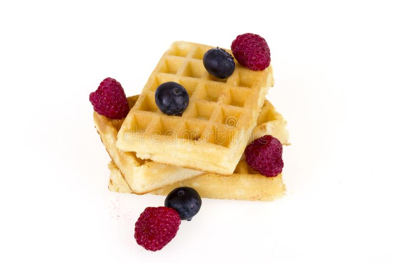 Belgium waffles with fresh berries royalty free stock images
