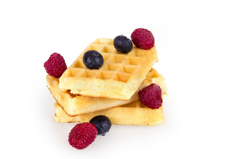 Belgium waffles with fresh berries stock images