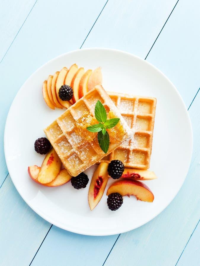 Belgium waffles with fruits and honey stock photos