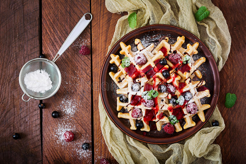 Belgium waffles with raspberries, chocolate and syrup stock photography