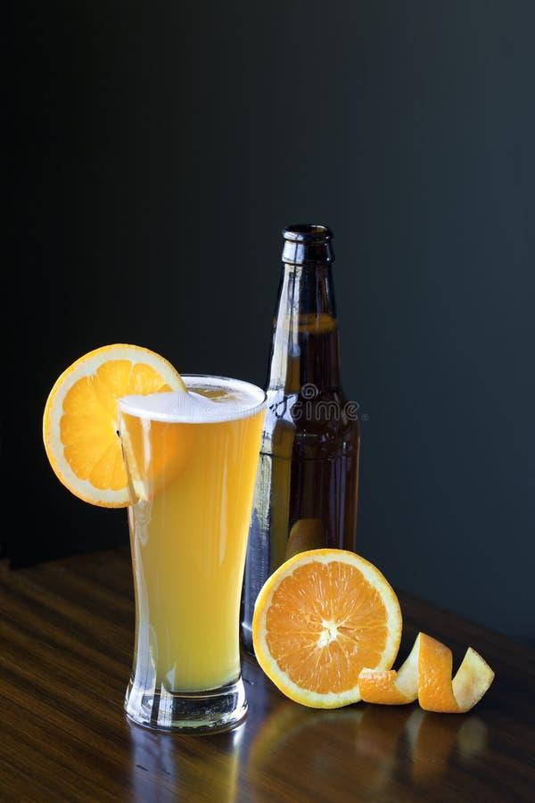 Belgium Wheat Ale With Orange Slice royalty free stock image