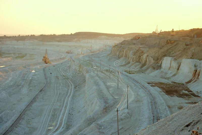 Belgorod chalk quarry in the golden rays of the sun low. Belgorod chalk quarry. Chalk and clay from the quarry used for the production of construction binders ( royalty free stock photo