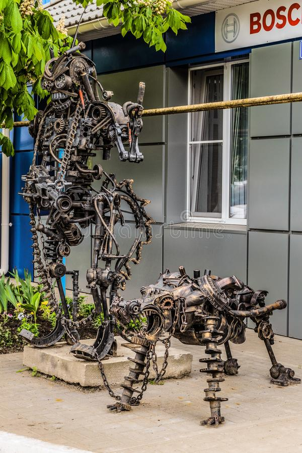 Street Metal Sculpture Of A Robot With Machine Gun And Robot Dog ...