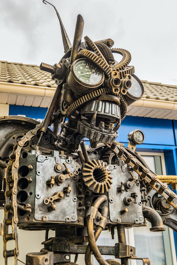 Street Metal Sculpture Of A Robot Made Of Old Cars Parts And Details ...