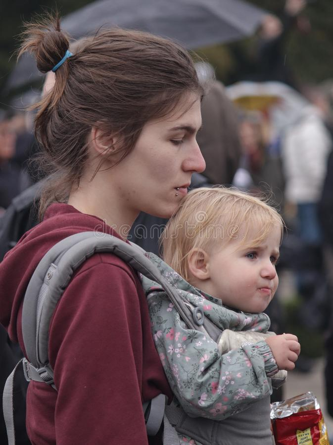 Young mother and her baby child at the protest stock images