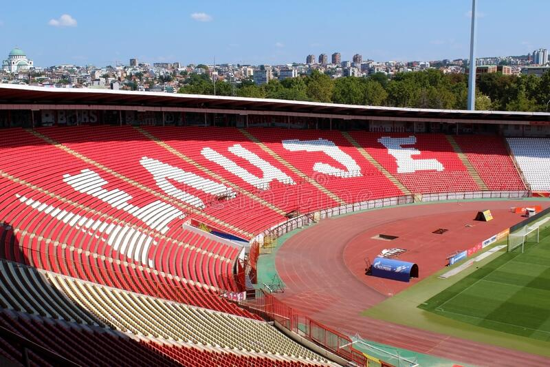 BELGRADE, SERBIA - AUGUST 2019: Red Star stadium Delije sector and city skyline. In the background stock images
