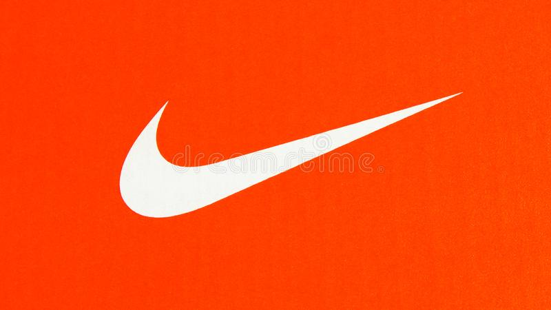 Nike white logo on cardboard orange sneakers box. Belgrade, Serbia -  July 11 2019. Nike swoosh. Nike white logo on cardboard orange sneakers box stock images