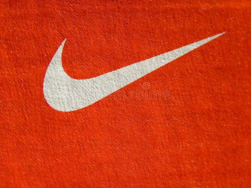 Nike white logo on cardboard orange sneakers box. Belgrade, Serbia -  July 11 2019. Nike swoosh. Nike white logo on cardboard orange sneakers box stock photos