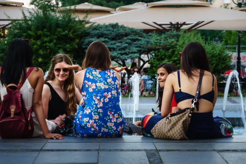 Belgrade,Serbia-June 10, 2019: Girls chatting near the fountain in the center royalty free stock photography