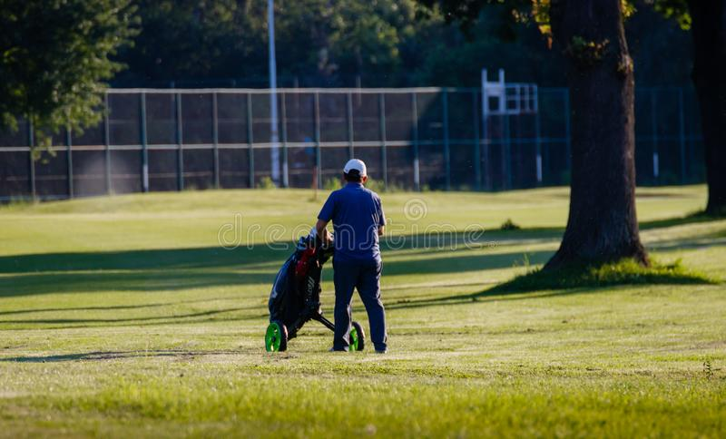 Belgrade, Serbia- June 1, 2019: Time to relax on the golf course, senior golfer at the golf course stock photo