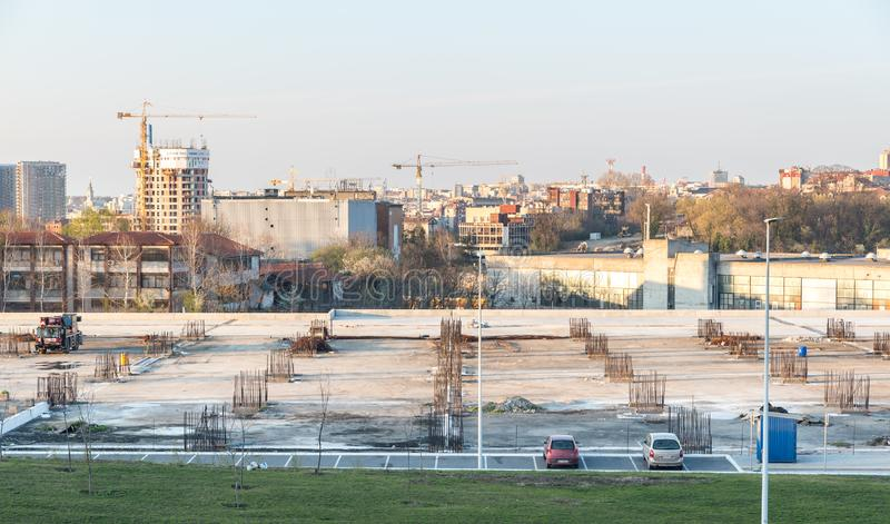 Construction site of the new multi story garage parking with concrete and steel reinforcement and Belgrade city in the background stock images
