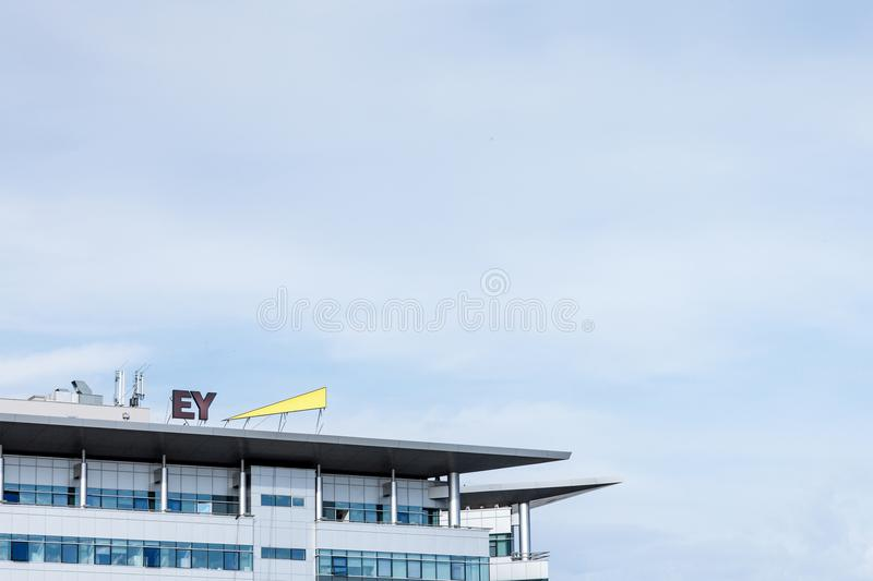 Ernst and Young EY logo on their main office for Serbia. EY is one of the leading companies in Business Services. BELGRADE, SERBIA - MARCH 30, 2018: Ernst and royalty free stock images
