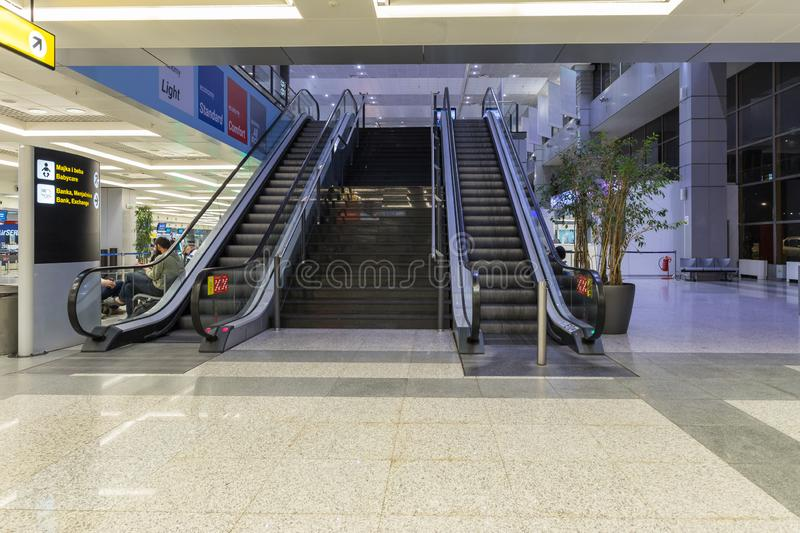 Escalator leading to the upper floor in the check-in lounge at the Nikola Tesla International Airport near the city of Belgrade in stock image