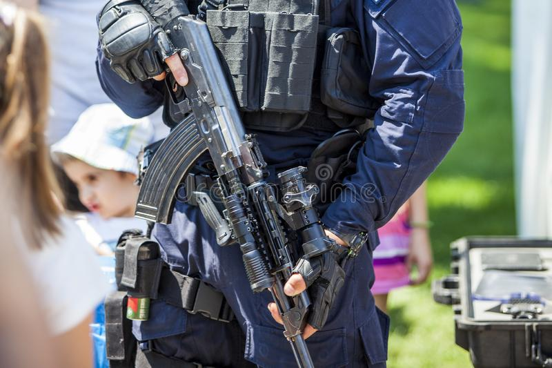 Armed policeman holding a rifle dressed in his uniform stock photography