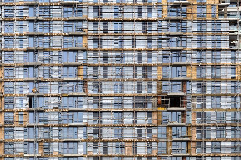 Scaffolding on highrise construction site background. BELGRADE, SERBIA - MAY 05, 2018: Scaffolding on highrise construction site background, building royalty free stock image
