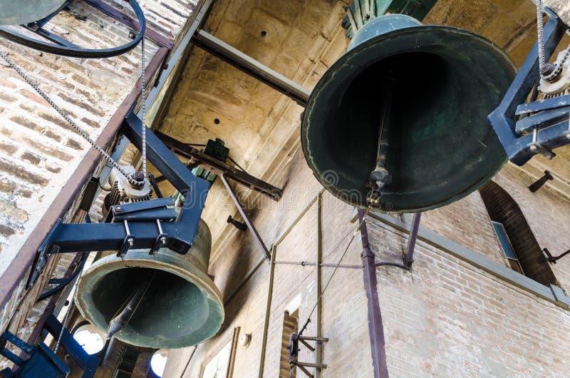 Belhi della torre antica Giralda, cattedrale, Siviglia, Spagna fotografia stock
