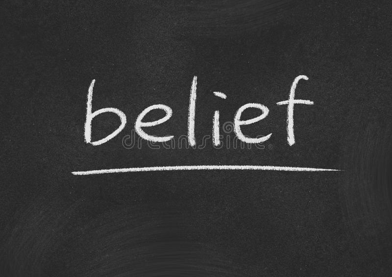 Belief. Concept word on a blackboard background royalty free stock images