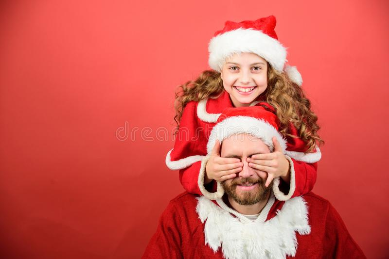 Belief in santa constitutes most magical part of childhood. Guess who. Surprise concept. Girl child and bearded father. Wear santa costume. How to be santa stock photos
