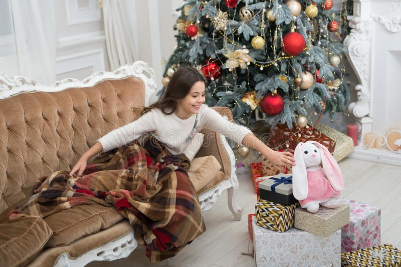 Believe in miracles. Magical moment. Christmas morning. Happy new year. Little girl sleep couch near christmas tree royalty free stock photography