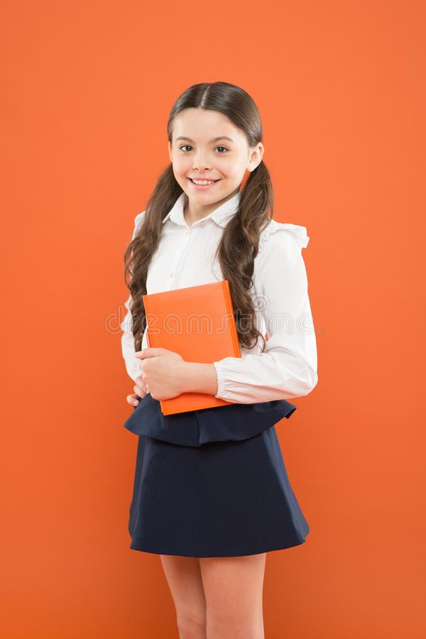 Believe in possibilities. Inspiration for study. Back to school. Knowledge day. Possible everything. Schoolgirl enjoy. Study. Kid school uniform hold workbook royalty free stock photo