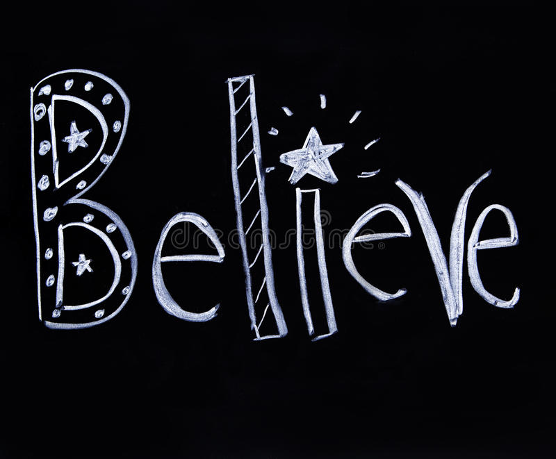 Believe scritto in gesso fotografia stock libera da diritti
