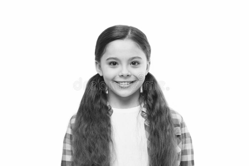 Believe in what your hair can do. Little girl with stylish ponytail hairstyle. Little child with brunette hair. Cute. Girl with long hairstyle. Small hair model royalty free stock image