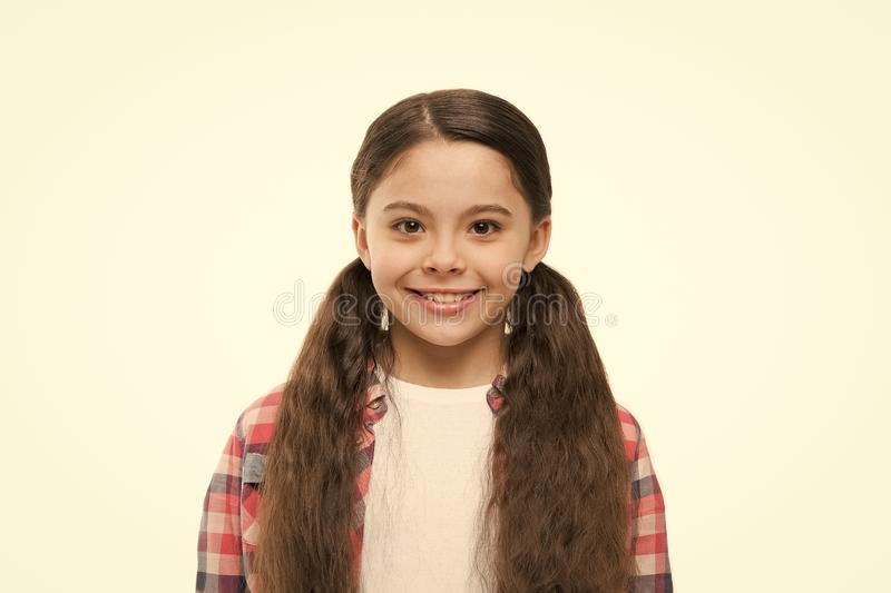 Believe in what your hair can do. Little girl with stylish ponytail hairstyle. Little child with brunette hair. Cute. Girl with long hairstyle. Small hair model royalty free stock photos