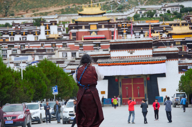Believer of Tashilhunpo temple. The temple also has a high status in Tibet, located in Shigatse City.It was another leader of Tibetan Buddhism: the palace royalty free stock photo