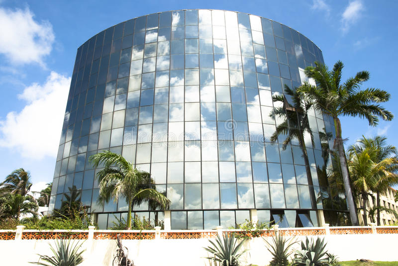 Belize Architecture. Modern building covered in glass in Belize City (Belize royalty free stock image