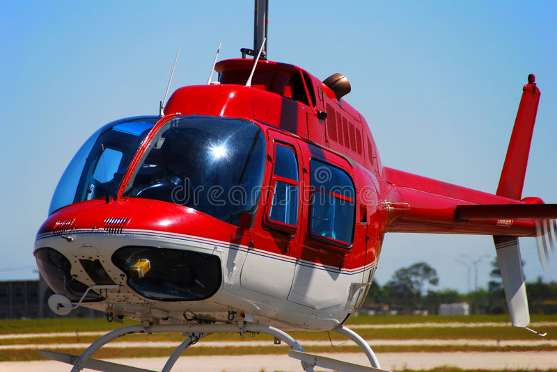 Bell 206 helicopter taking off stock photography