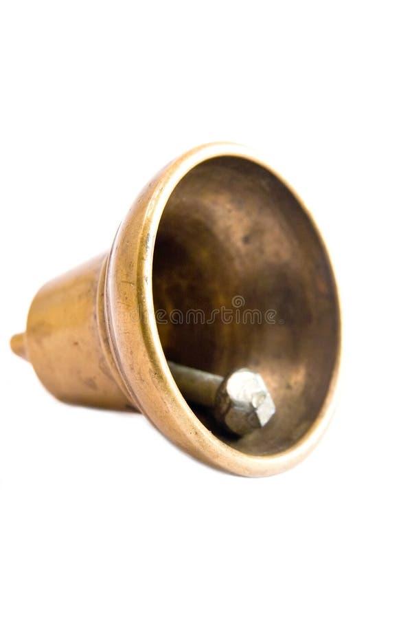 Bell. Single small metalic bell macro close up lightbox stock photography