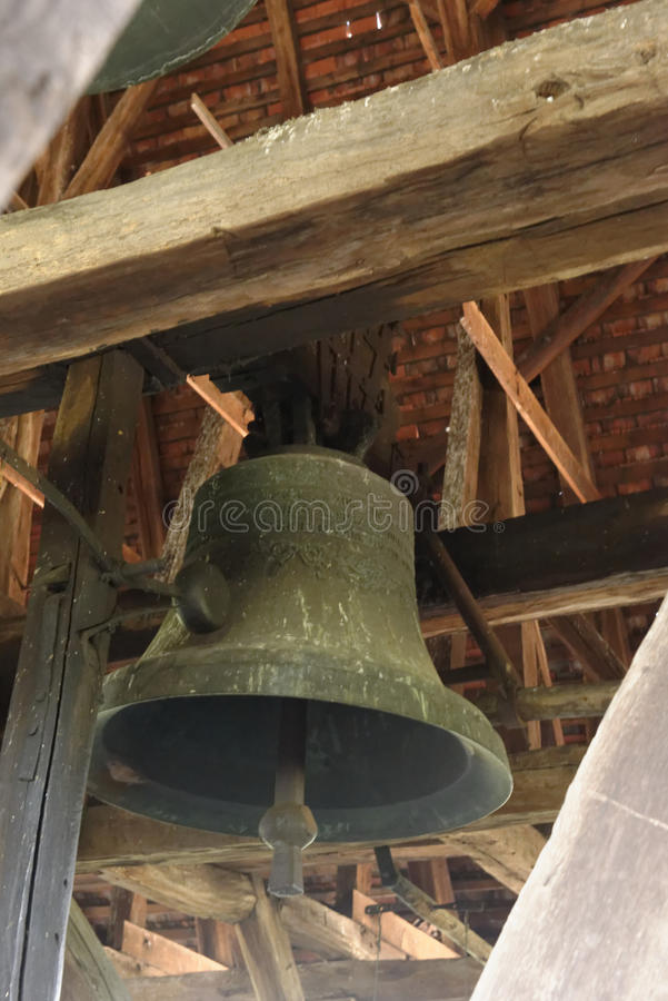 Bell in Axente Sever Church in Frauendorf, Romania. Old bell in tower of Axente Sever Church in Frauendorf, Romania royalty free stock photos