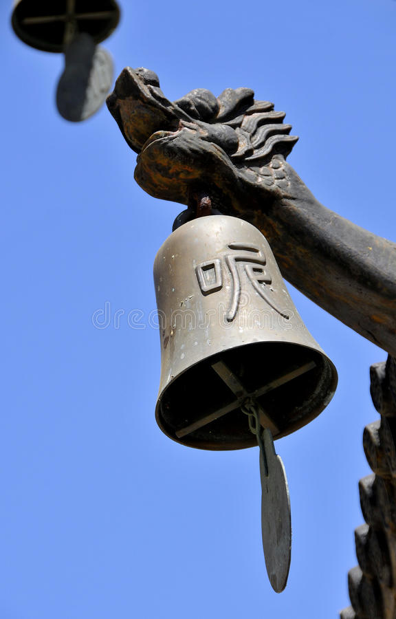 Bell at Buddhist Temple. Wind Chime Bell in Front of Buddhist Holy Temple in Northern California stock images