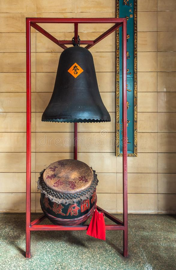Bell and Drum at Tung Shan Temple, Hong Kong China. Hong Kong, China - March 8, 2019: Tung Shan Temple in Wing Ping Tsuen Neighborhood. Black Bell and brown-red stock photo