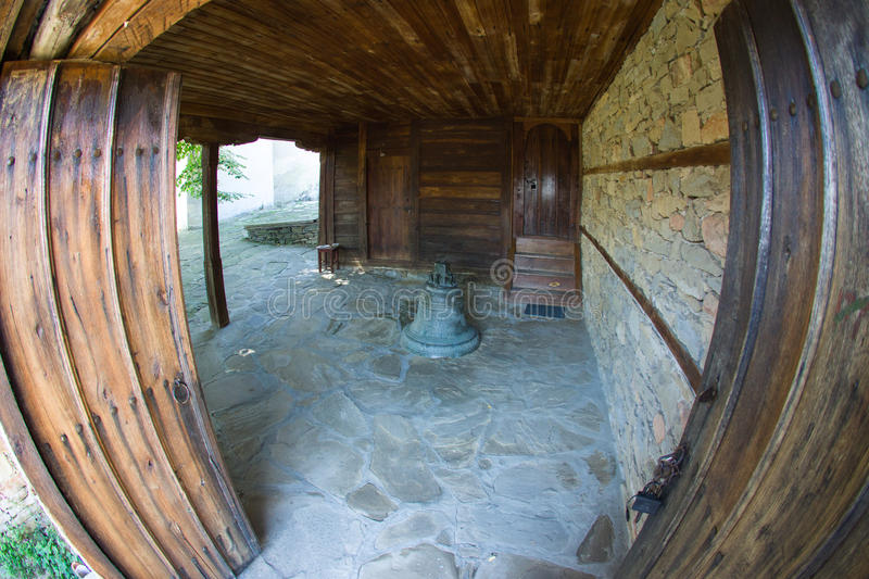 Bell at the entrance to the temple of St. Nicholas in the Bulgarian village of Zheravna stock photo