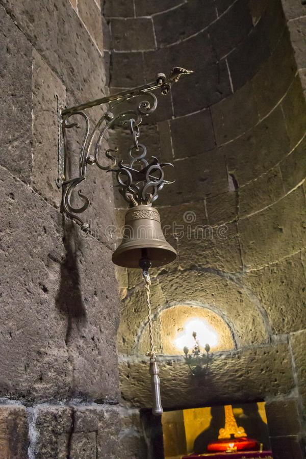 Bell hanging on the stone wall of an old temple. royalty free stock photo