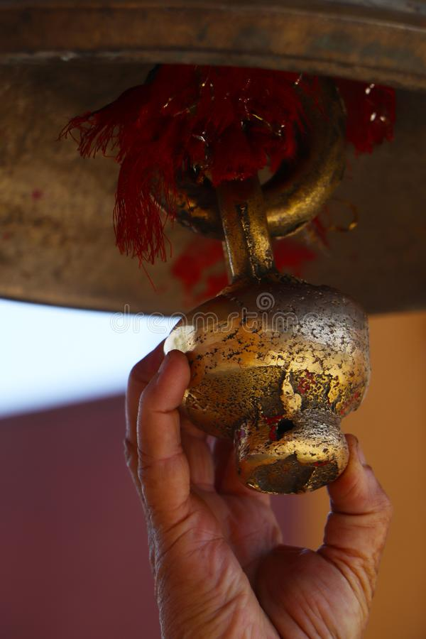 Bell in the Hindu temple. Ring the bell after the prayer. A place for prayer. Hindu altar. Interior of a small temple. A bell made of yellow metal. Temple bell royalty free stock photos