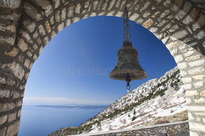 Bell of Panagia Orthodox Church on Mount Athos. Bell in the arch on the background of the sea at Church of Intercession on Mount Athos, Agion Oros (Holy Mountain royalty free stock image
