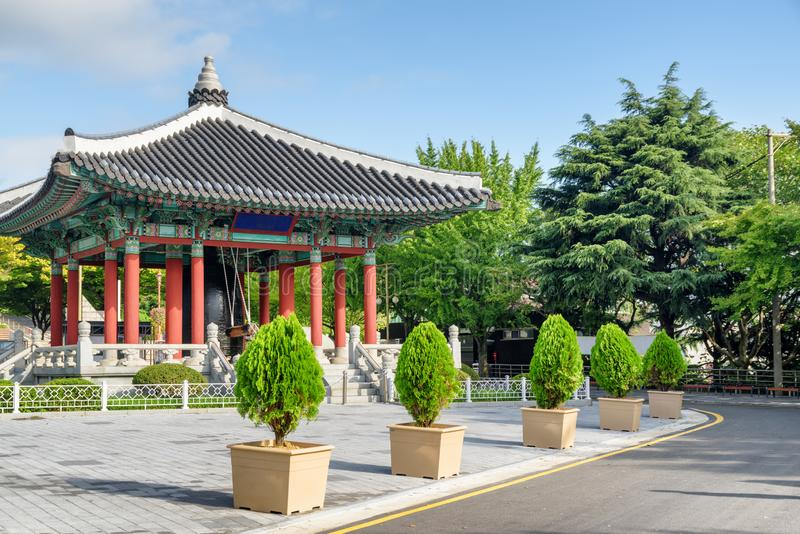 Bell pavilion of traditional Korean architecture, Busan. Wonderful view of colorful bell pavilion of traditional Korean architecture on blue sky background at royalty free stock photography