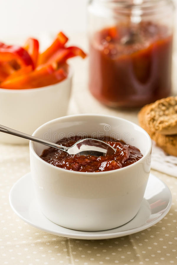 Bell pepper relish. Homemade red bell pepper relish in a bowl stock photo