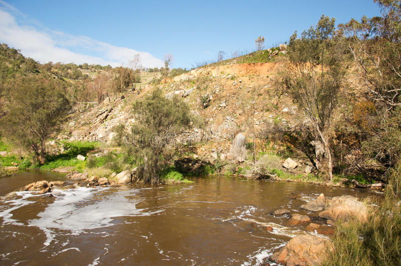 Bell Rapids Riverbank. Bell Rapids and riverbank with granite rock and treed riverbanks under a blue sky with clouds in the Swan Valley of Western Australia royalty free stock images