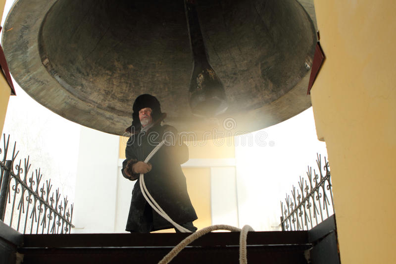 Bell-ringer in the belfry stock images