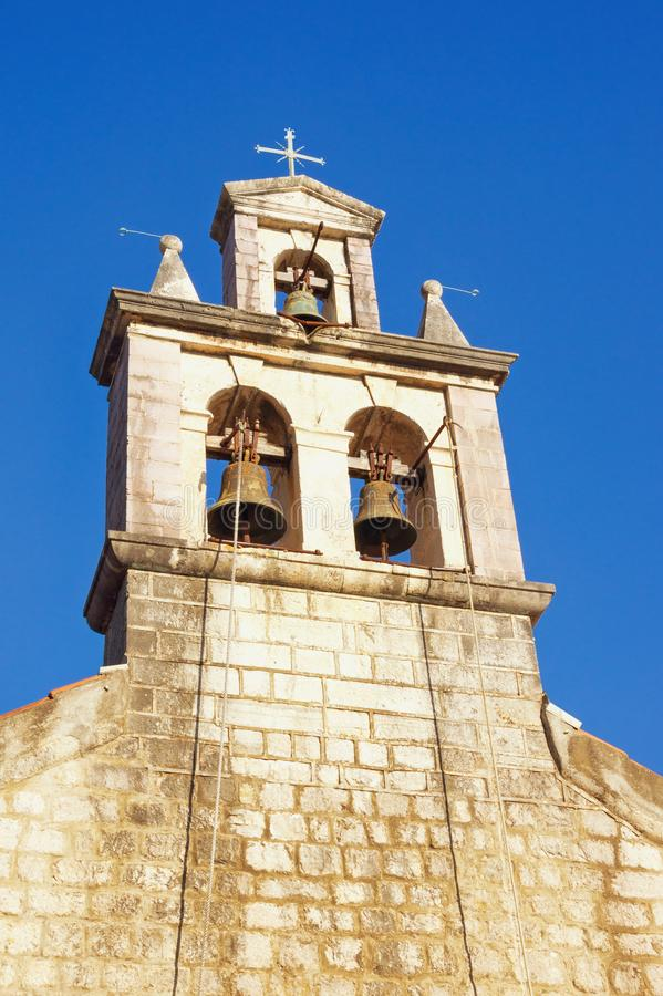 Bell tower against blue sky. Montenegro. Church of St. Anthony of Padua in Lepetane village. Bell tower against blue sky.  Montenegro. Catholic Church of St royalty free stock photo