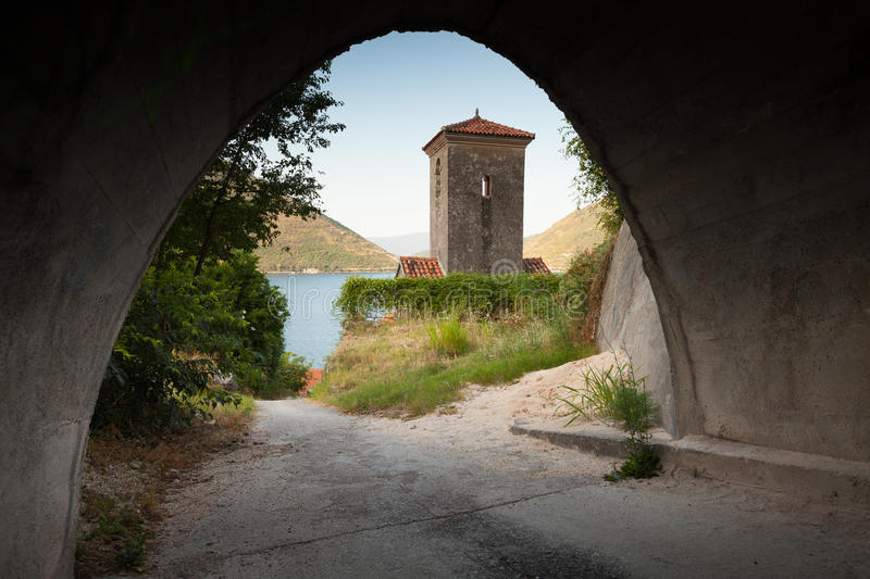 Bell tower of ancient Orthodox church. Perast stock photography
